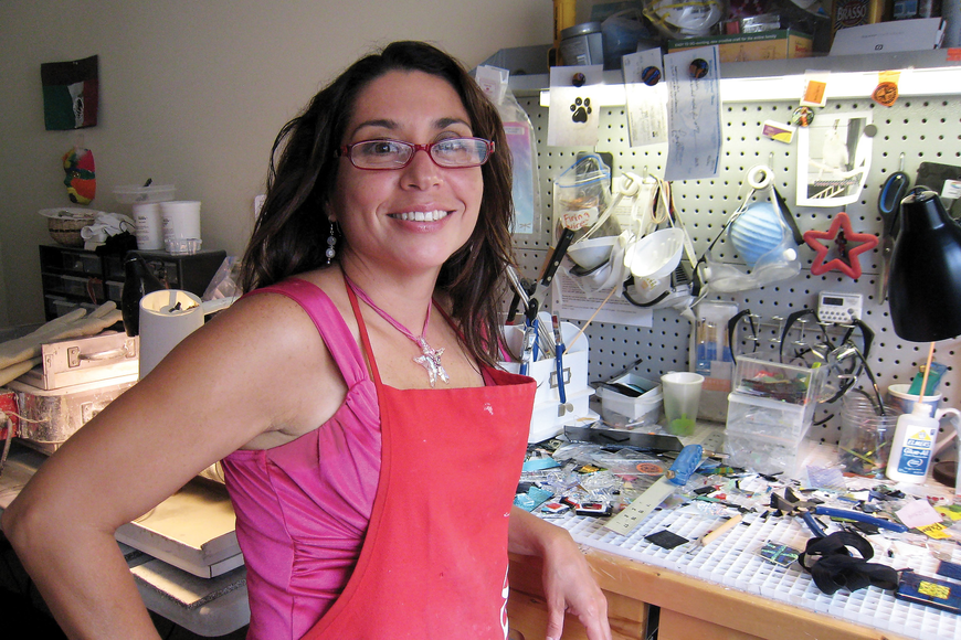 Silvia Engel, wearing one of her customized necklaces, lets light shine through the windows of her home studio and listens to upbeat music when she crafts jewelry made with ashes.