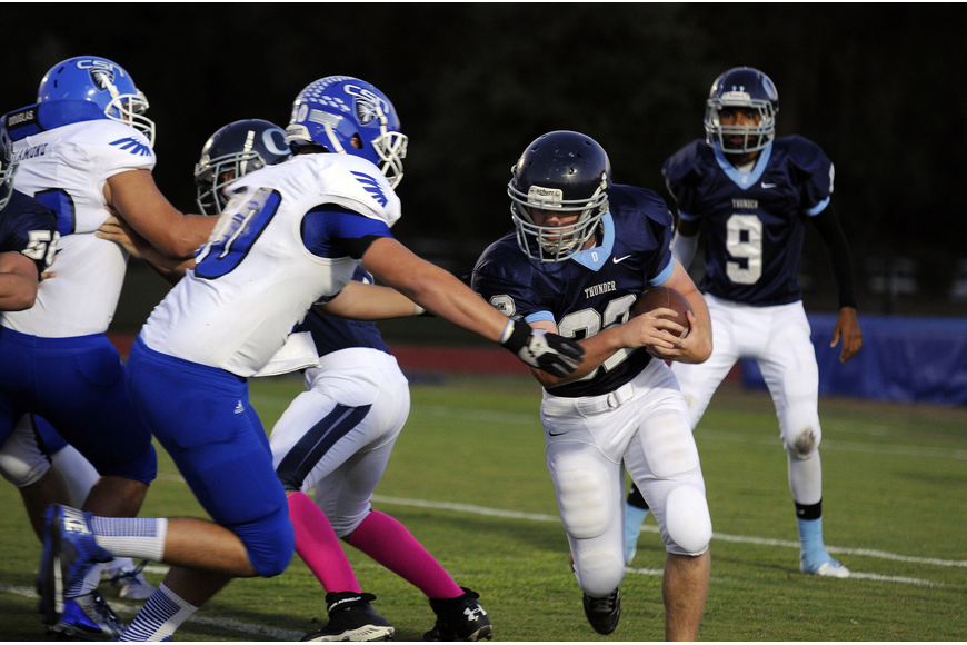 ODA sophomore running back Chris Poole carries the ball on the Thunder's opening possession.