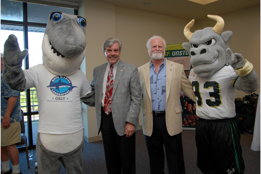 Mote mascot Gilly the Shark, Dr. Arthur Guilford, regional chancellor of USFSM, Dr. Michael Crosby, president and CEO of Mote, and USFSM mascot Rocky D. Bull. (Courtesy USF Sarasota-Manatee)
