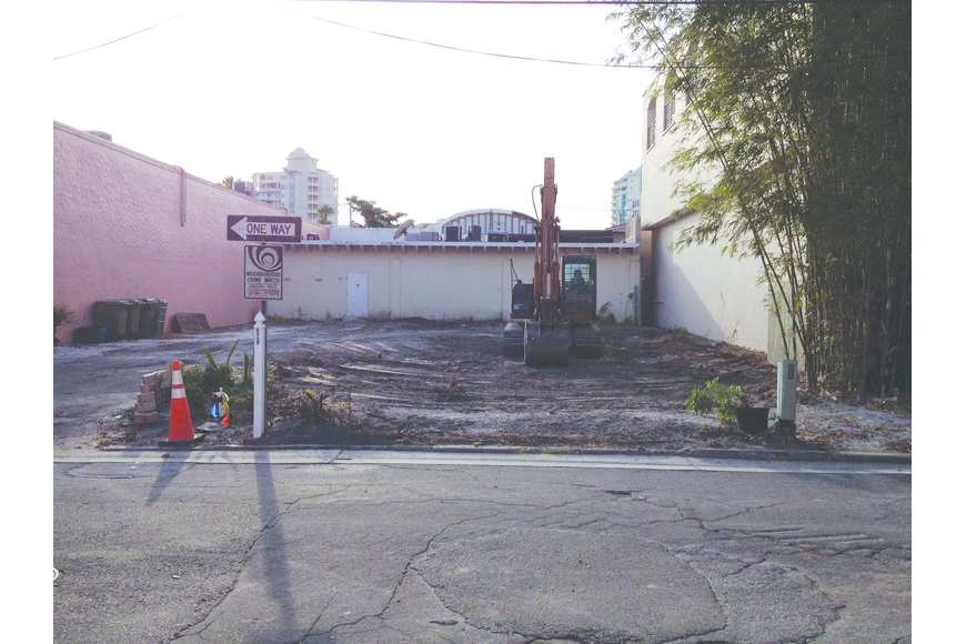 Construction crews demolished a historic building abutting Laurel Park this month for the proposed expansion of a philanthropic consignment shop.
