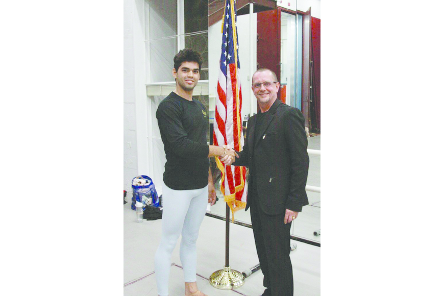 Courtesy Photo. Sarasota Ballet Artistic Director Iain Webb welcomed Cuban defector Edward Gonzalez to the ballet and freedom in March.