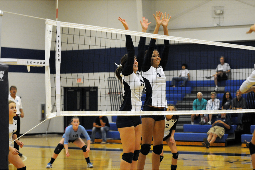 Juniors Monica Costa and Reanna Gregory go up for a block in the second set.