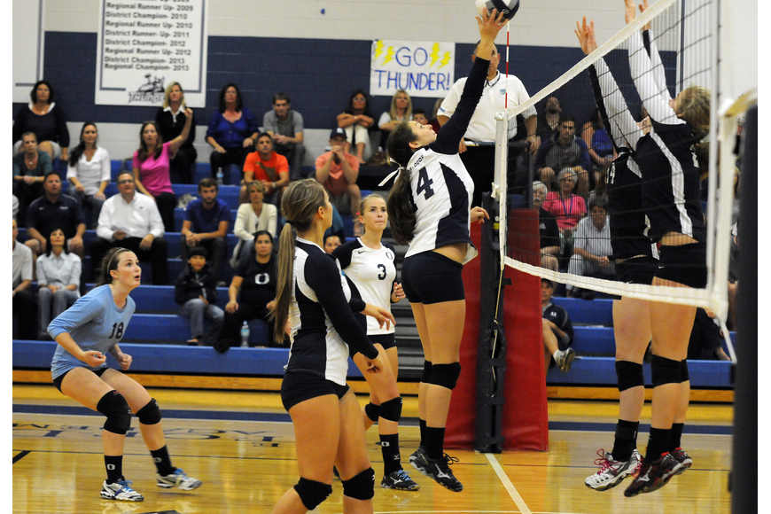 ODA's Taylor Albano tips the ball back over the net for a point late in the fourth set.