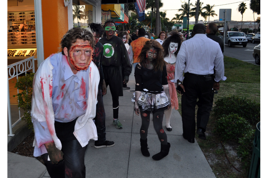 Sarasota High School students dressed as zombies circled St. Armands at last year's Fright Night. (File photo)