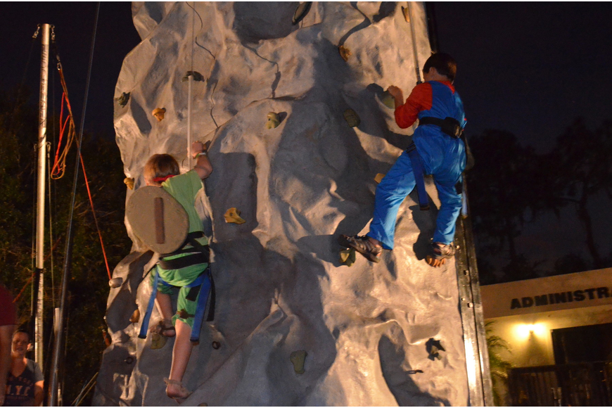 Jordan Spencer and Ethan Dobson climb the rock wall.