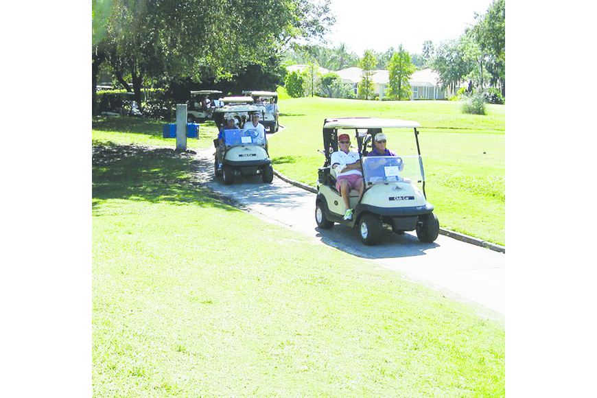 More than 100 golfers turned out for the event, which raised more than $5,000 for local charities.
