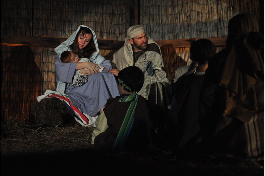 Mary and Joseph, portrayed by Emily Arakel and Joe Mascitto, welcome children to see the newborn child.