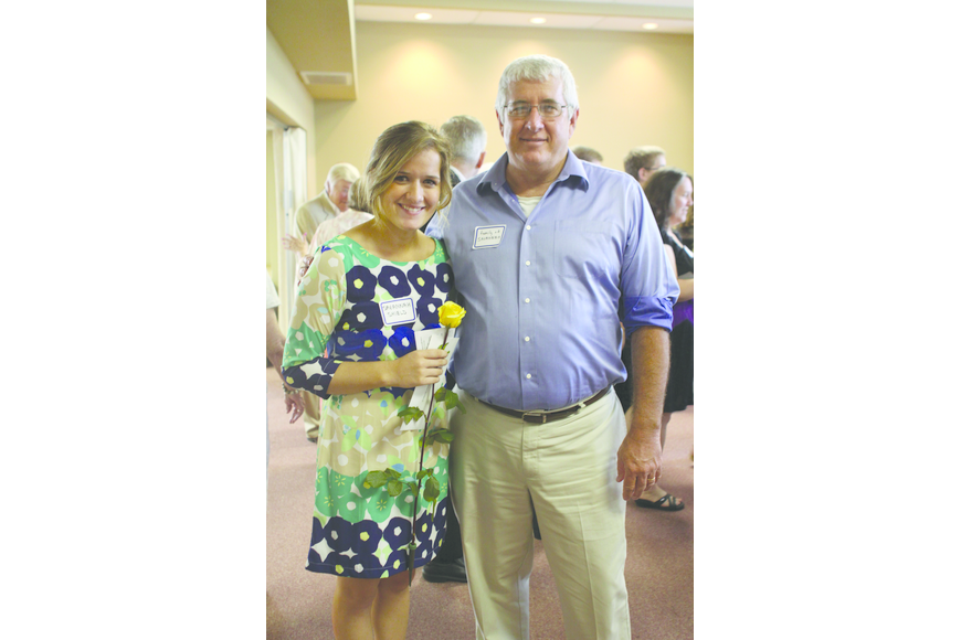 Longboat Key native Savannah Schield, with her dad, Steve, is one of 18 students who received scholarships from Longboat Island Chapel May 12.
