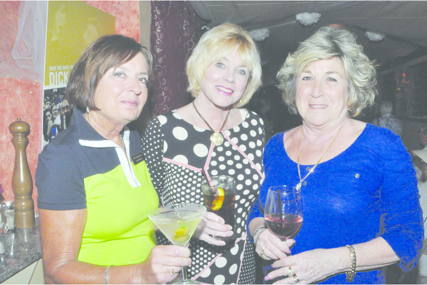 Jan Haynes, Nancy Vercauteren and Judy Heath raise their glasses April 3, at Restaurant Le Colonne, at a gathering of the Armalido Martini Club.