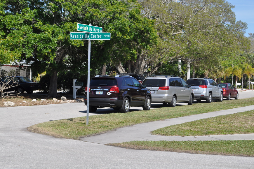 Avenida de Mayo has become a site for overflow parking from Siesta Key Village and the public beach.