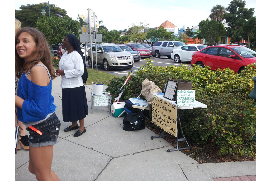 A woman soliciting donations on St. Armands Circle is upsetting merchants and has BID board members worried it's causing a problem for the popular shopping destination. (Courtesy photo)