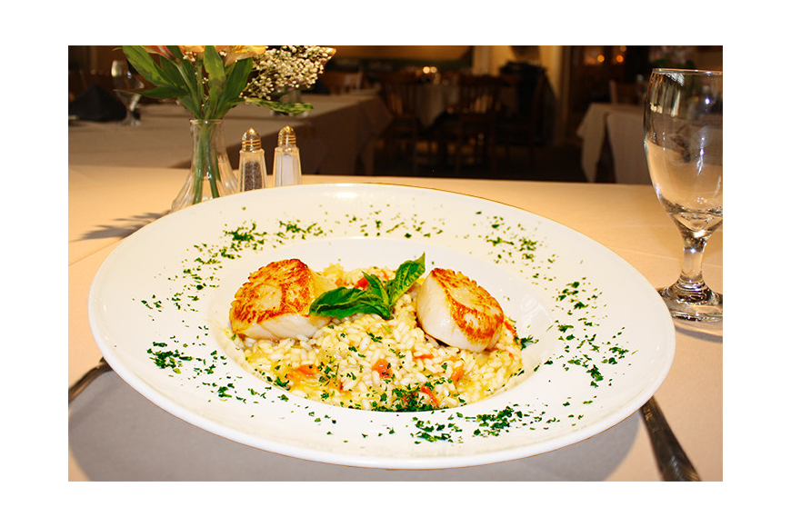 Cafe Baci serves classic Italian dishes with specialties in Roman and Tuscan cuisine.