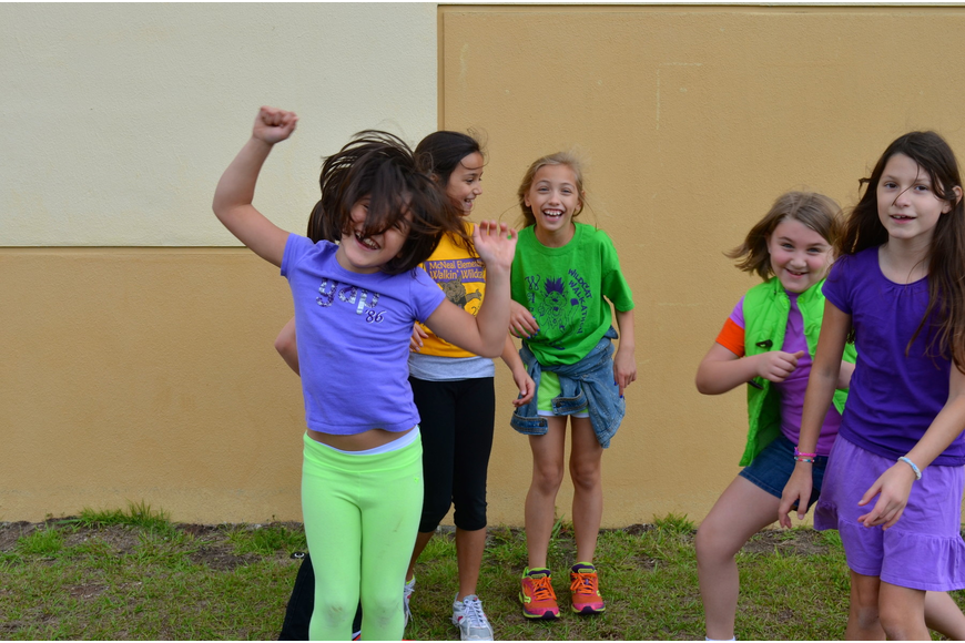 McNeal Elementary students dance around to pop songs after participating in the Walk-a-thon.