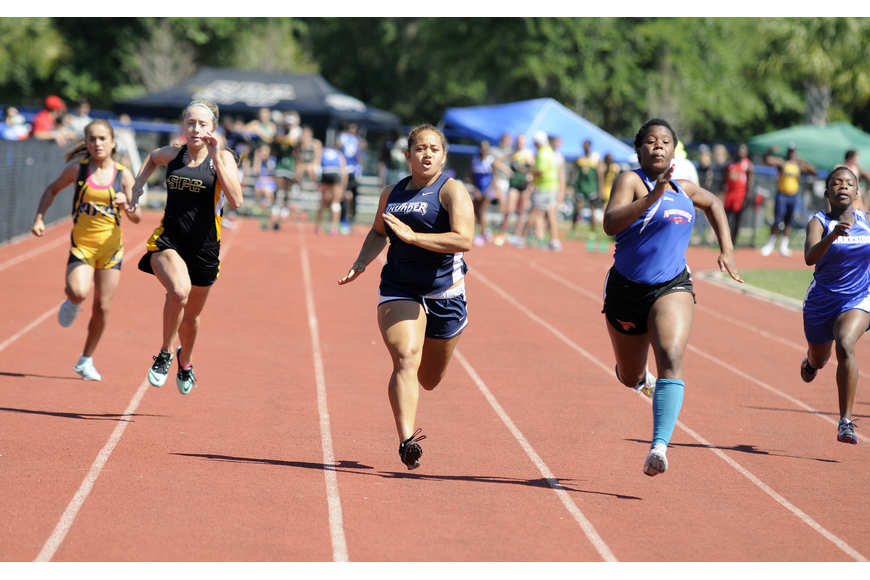 ODA's Sierra Dickerson races down the track in the preliminaries of the 100-meter dash.