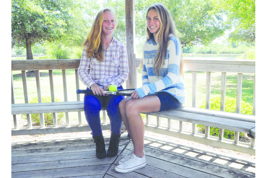 Out-of-Door Academy tennis players Mary Ann Rompf and Maria Ross will play together on the junior tennis circuit this summer. They hope to defend their state titles in the spring. Photo by Jen Blanco