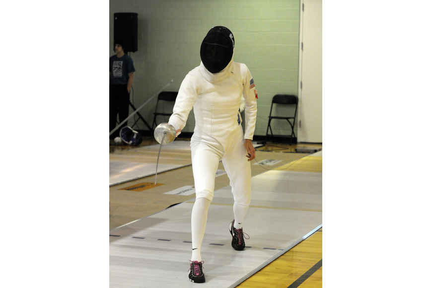 Margaux Isaksen competed in the mixed relay round robin fencing event for the United States.