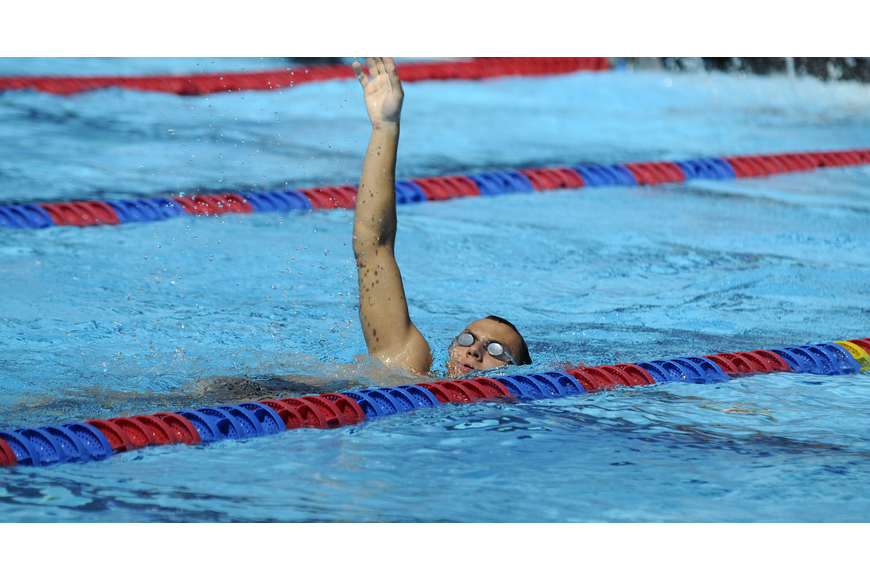 Pavel Ilyashenko warms up before the start of the 200-meter freestyle mixed relay June 8.
