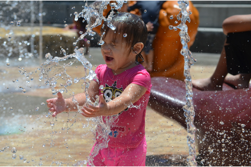 Sophia Colon, 1, cools off at the Children's Fountain Tuesday, June 10, at Bayfront Park. The Children's Fountain is open daily 10 a.m. to 7 p.m. through Labor Day, weather permitting.