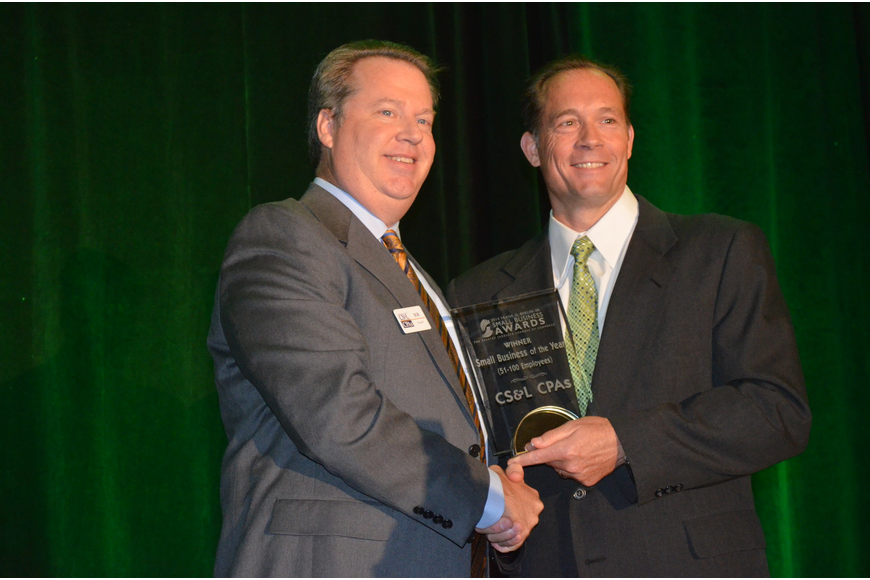 Pat Dorsey presents the Small Business of the Year (51 to 100 Employees) Award to Bob Stanell of CS&L CPAs.