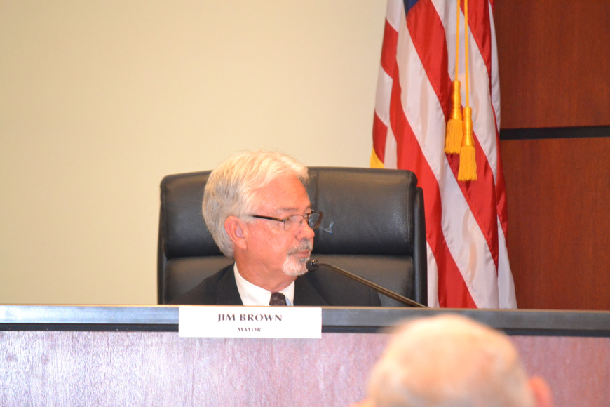 Mayor Jim Brown called for a show of hands Monday that led to another decision not to move forward with discussions about burying the Key's power poles.