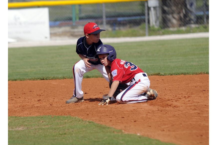 Sarasota American 9/10 All-Star Austin Harford slides safely into second base.