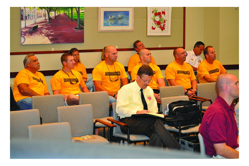 Longboat Key firefighters wore matching yellow T-shirts as they sat in the back of the Town Hall Chambers listening to attorneys present their case during a contract impasse hearing Thursday, Sept. 16.