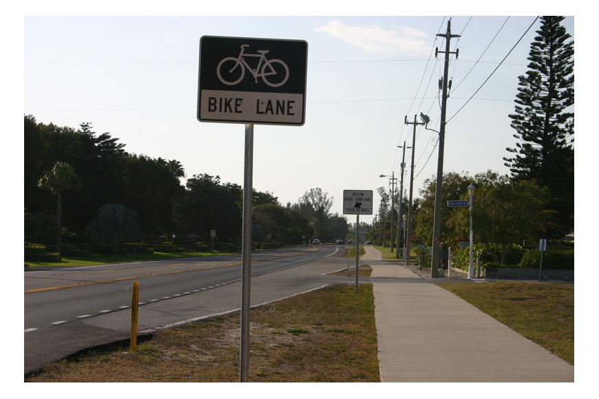 The Florida Department of Transportation promises to work to reduce signs along Gulf of Mexico Drive.