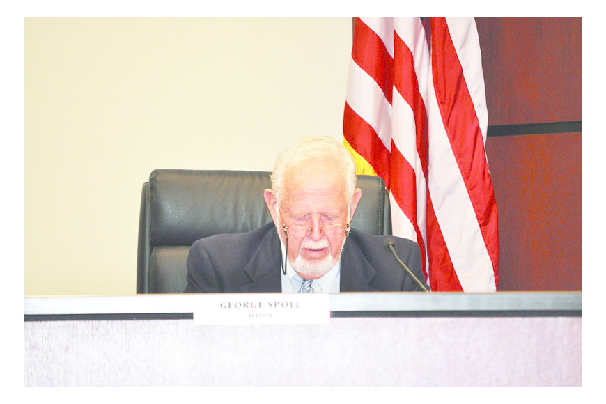 Mayor George Spoll reads through the Town Commission's regular meeting agenda Monday, Oct. 4, at Town Hall.