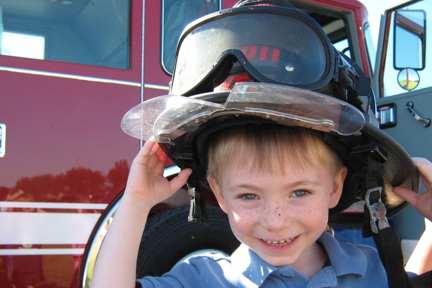 Ayden Kirk was all smiles as he tried on a firefighter's helmet.