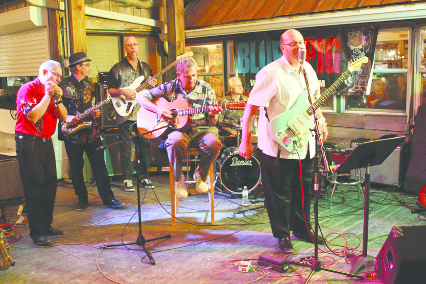 "Town Manager Bruce St. Denis plays guitar with Blues Pig to a James Taylor classic, ""Steamroller."""