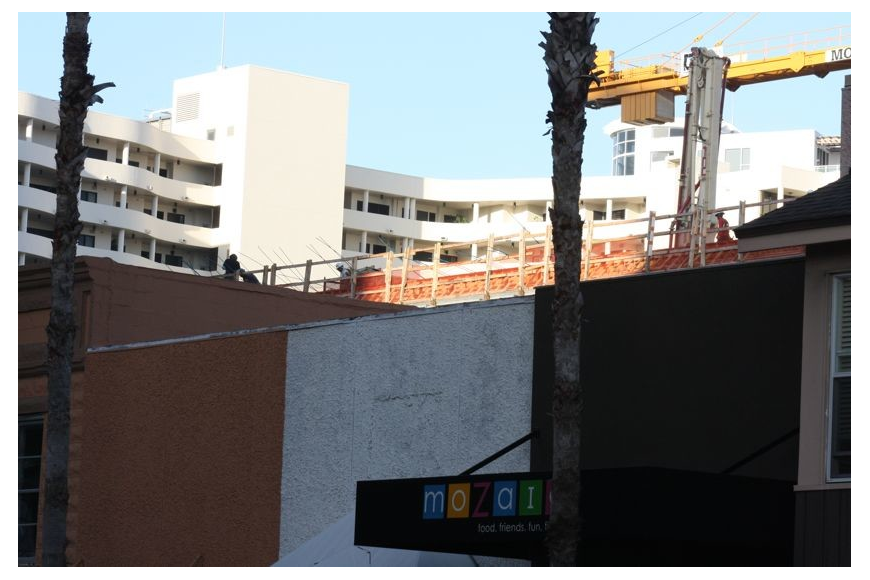 The top level of the Palm Avenue parking garage can now be seen over the rooftops of lower buildings on Main Street.