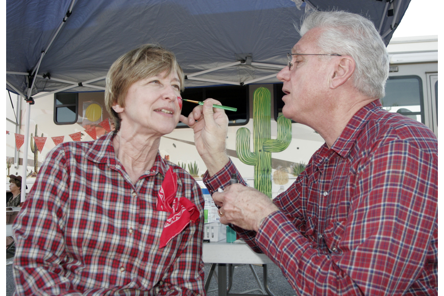 Sarasota Baptist Church members Mary and Joe Brannon volunteered to work the face painting booth.