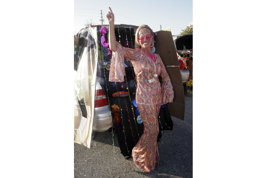 Disco Queen Melinda Slicis passed out candy during trunk-or-treat.