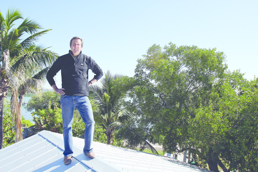 Mar Vista Dockside Restaurant & Pub owner Ed Chiles shows off the view from his restaurant's roof.