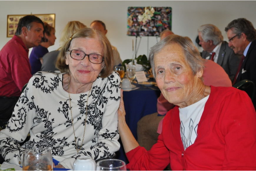 Marlene Pust, the first person to volunteer at the Senior Friendship Center Living Room, and Betty Wendholt