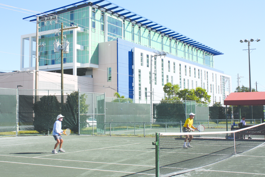 Some tennis players have refused to play on the three courts nearest to the police headquarters, because the air-conditioner noise is too loud for them.