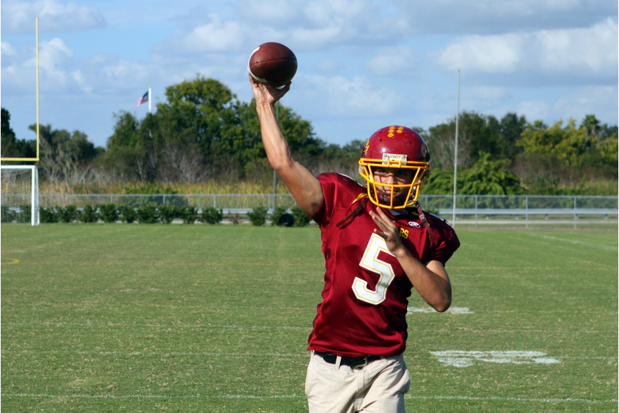 Alex Nugent, senior at Cardinal Mooney, throwing the football around with a friend.