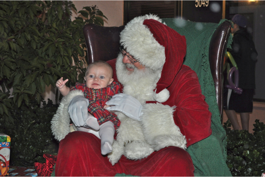 Jordyn Hanwright tells Santa Claus what she wants for Christmas.