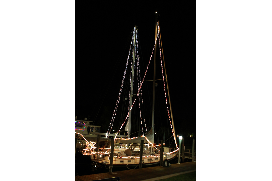 Two sailboats light up the docks at Bird Key Yacht Club.