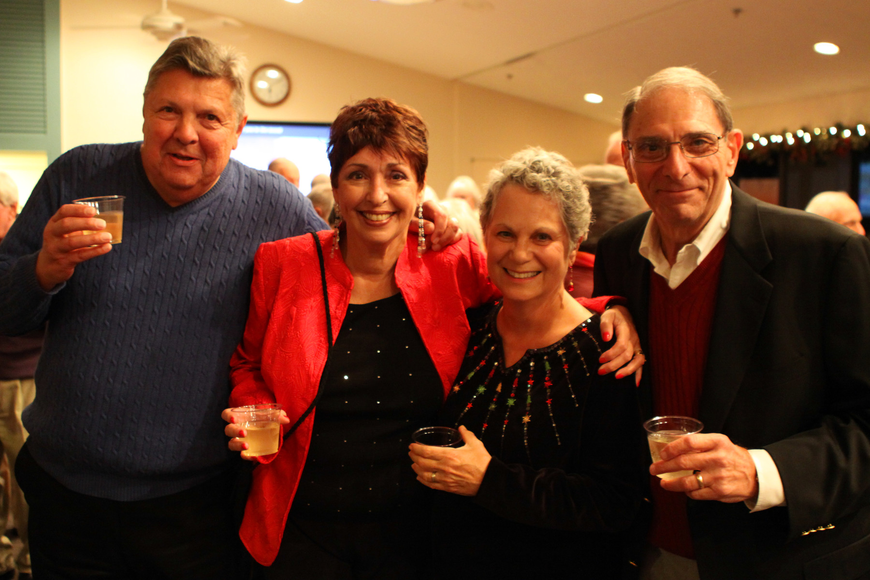 Robert and Sandy Endres raise their glasses with their friends Sally and Terry Kall.