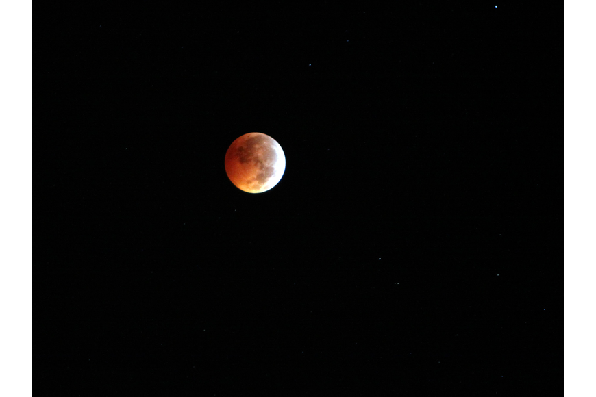 During a total lunar eclipse, the full moon passes behind the Earth, which blocks the sun's rays from hitting the moon.