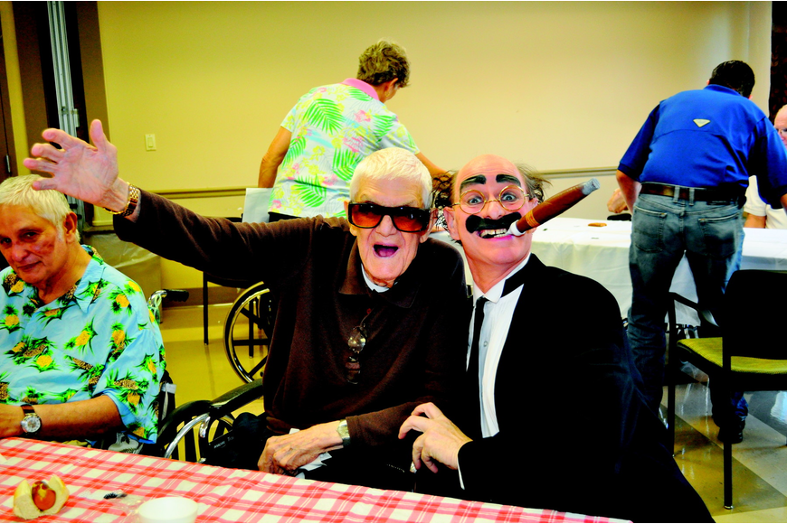 Herb Lee and Chuck Sidlow joked around in June at The Pines of Sarasota feast and casino party.