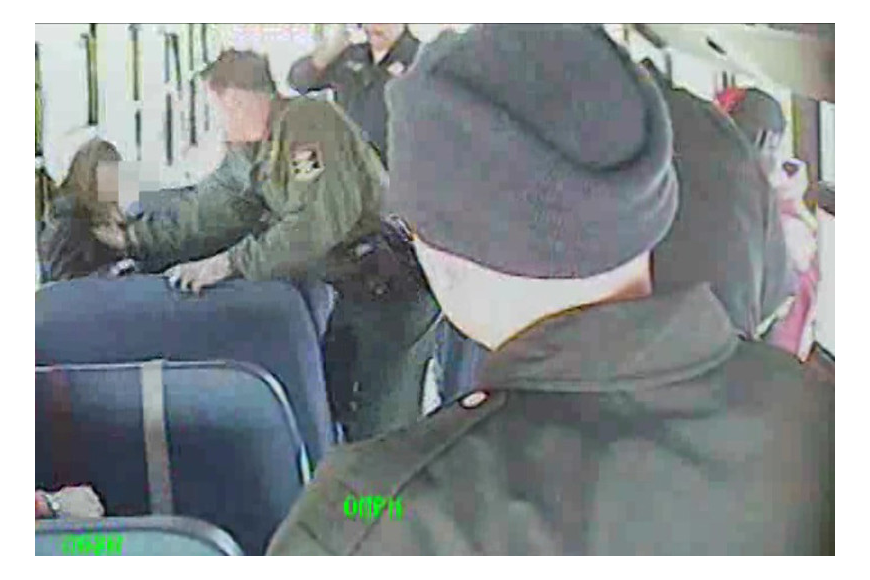 Surveillance tape shows Dep. Mark Perrin grabbing a teenage girl and throwing her out of her seat.