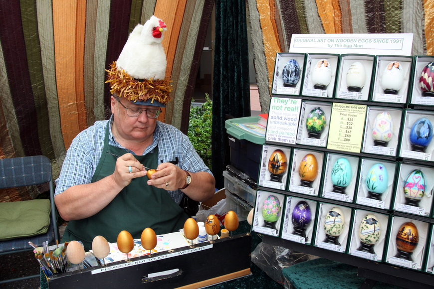 The Egg Man, Alan Traynor, works on painting some solid wood eggs during the 17th annual Siesta Key Craft Festival Saturday, Feb. 5, in Siesta Key Village.