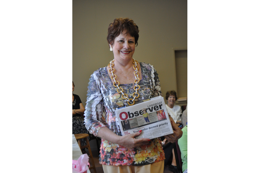 Patti Kertz was ready to relax and catch up on local news with her copy of the Longboat Observer.