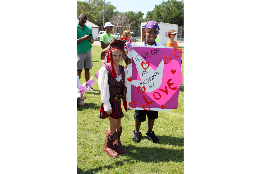Dana Habedank, 8, and Kaitlyn Sparks, 15,  hold the anchor at the end of the Bank of America paper chain during 2011's Relay for Life on Saturday, April 9 at Sarasota High School.