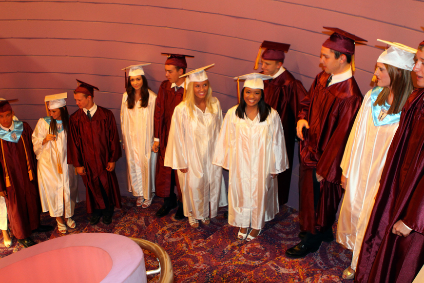 Students line up on the spiral staircase and wait to be told to begin walking in for their graduation ceremony Friday, May 27 at the Van Wezel Performing Arts Hall.