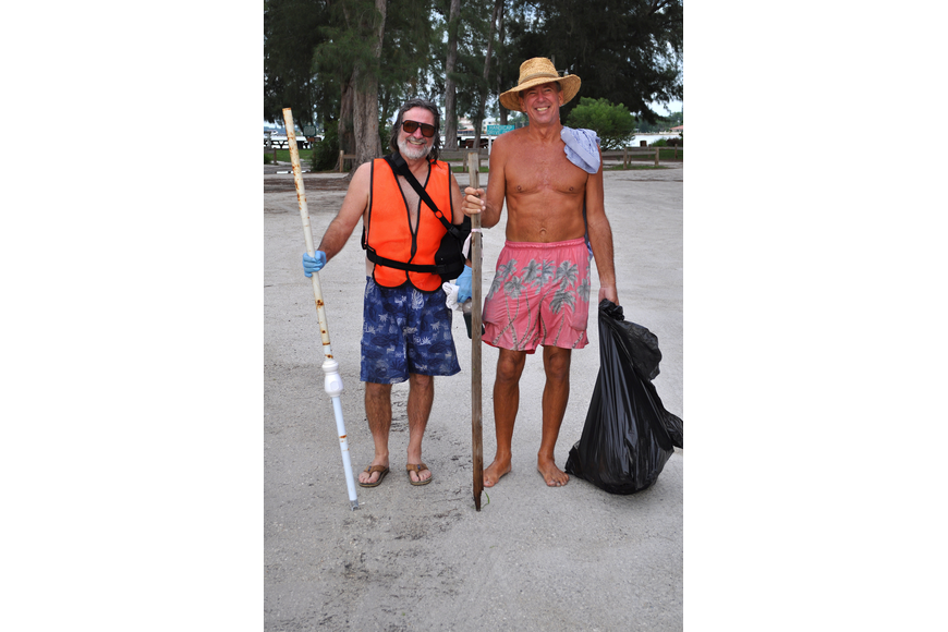 Mitch Malone and Gary Sibole filled two garbage bags during the Barefoot Wine Beach Cleanup Thursday, Sept. 8, at Ted Sperling Park.