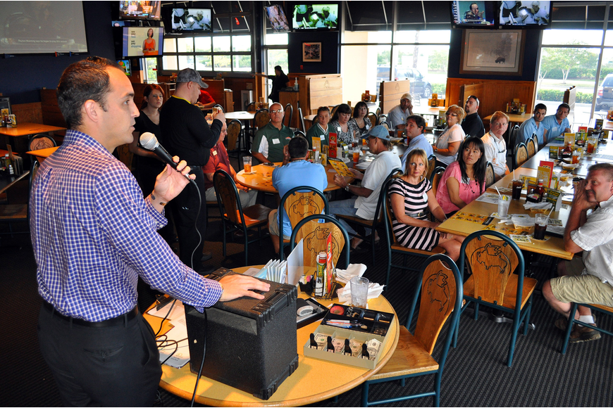 Kevin Cooper talks to the people who attended the Siesta Key Chamber luncheon Friday, Oct. 7 at Buffalo Wild Wings.