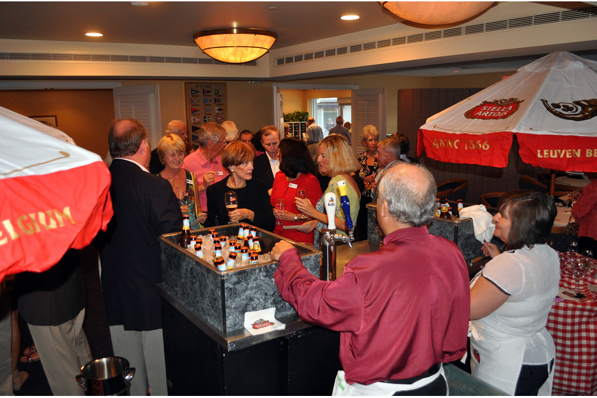 Members of BKYC stand around trying out different Belgian beers and rated them, Saturday, Oct. 22 at Bird Key Yacht Club.